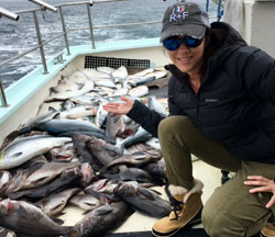 Linda with a boat full of Alaskan halibut, silver salmon and rock fish